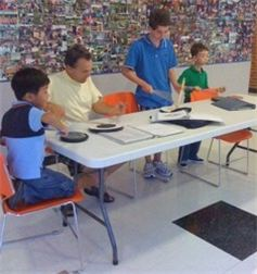 Drum Sergeant Doug Brown teaching student drummers how to read and play traditional Scottish drum music.