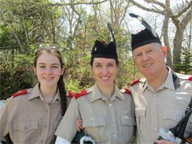Three generations of Bagpipers play with the Highland Light.