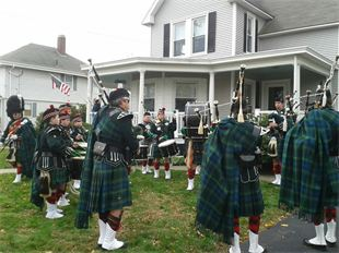 The bagpipers and drummers of the Highland Light Scottish pipe band warming up before the Thanksgiving parade in Plymouth, Ma