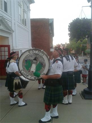 The drummers of the Highland Light performing outside a local south-eastern Massachusetts pub